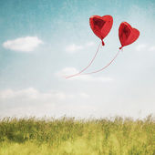 Heart balloon in blue sky — Stock Photo