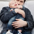 Stock Photo: Portrait of father with his baby boy