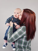 The girl the teenager kisses the baby — Stock Photo