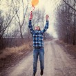 The cheerful boy with a balloon — Stock Photo