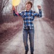 The cheerful boy with a balloon — Stock Photo #24684311