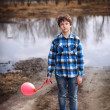 The sad boy with a balloon — Stock fotografie