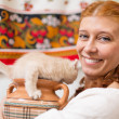 Stock Photo: Girl with jug and kitten