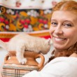 The girl with a  jug  and kitten - Stock Photo