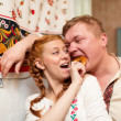 Russian couple in national costume — Stockfoto