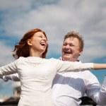 Playful couple enjoying outdoors — Stock Photo