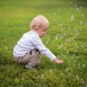Little boy and soap bubbles — Stock Photo