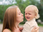 Crying Little Boy who is Being Held by her Mother — Stock Photo