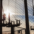 Stock Photo: Electrical power transformer in high voltage substation.