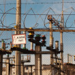 Electrical power transformer in high voltage substation. — Stock Photo #34233567