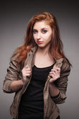 Young girl in a leather jacket represents model — Foto de Stock
