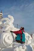 "Festival ""Magic ice of Siberia"", sculptor creates a sculpture f — Stock Photo"