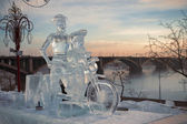 Don Quixote and it squire on a bicycle, a sculpture from ice — Stock Photo
