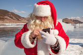 Santa Claus standing outdoors at ice — Stock Photo