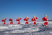 Procession of Santa Claus in the snow-covered terrain — Stock Photo