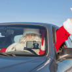 Santa Claus in  car — Stock Photo #48182577