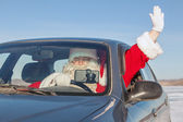 Santa Claus in  car — Stock Photo