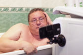Man relaxing in a  bathtub  — Stock Photo