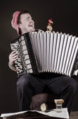 Russian poor man with an accordion and vodka — Stock Photo
