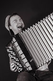 Russian man plays the accordion and sings — Stock Photo