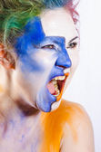Woman with painted face shouting — Stock Photo