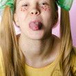 Royalty-Free Stock Photo: Teenage girl showing tongue