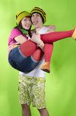 Loving couple in rasta-cap plays the fool — Stock Photo