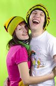 Loving couple in rasta-caps — Стоковое фото