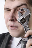 A man with a wrench — Stock Photo