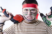 Spiteful man in war paint with two drills — Stock Photo