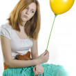 Girl with a yellow balloon — Stock Photo
