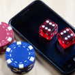 Mobile phone, Poker Chips and Dices - Stock Photo