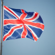 Union Jack - UK flag in the wind — Stock Photo