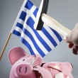 Robbing Greek piggy bank — Stock Photo