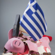 Stock Photo: Robbed piggy bank Greek flag, hammer