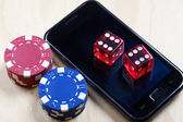 Mobile phone, Poker Chips and Dices — Stock Photo