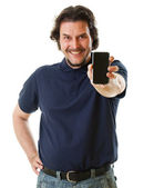 Mid-aged man in blue shirt holding smart phone — Stock Photo