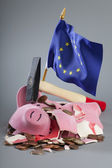 Robbed piggy bank an EU flag — Stock Photo