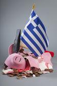 Robbed piggy bank Greek flag, hammer — Stock Photo