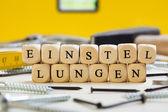 Letter Dices Concept: Einstellungen (German) — Stock Photo