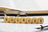 Letter Dices Concept: Sources — Stock Photo