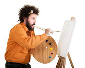 Eccentric painter in frantic painting — Stock Photo