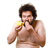 Wild guy eating a banana — Stock Photo