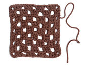 Crochet Doily - Brown Granny Square — Stock Photo