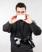 Waist up portrait of a mature adult Caucasian man as photographe — Stock Photo