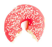 Half eaten red Donut with sugar sprinkles — Stock Photo