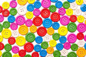 Colorful sewing buttons background — Stock Photo