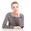 Young blond woman sitting on table — Stock Photo