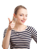 Young blond woman pointing and winking — Stock Photo
