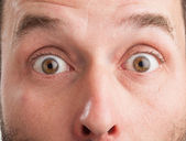 Mature Caucasian man, closeup, surprised look — Stock Photo
